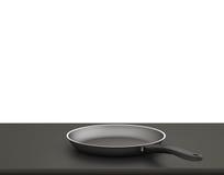 Fondo bianco isolato Pan On The Table On vuoto Fotografie Stock