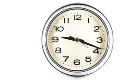 Fondo blanco aislado del reloj de pared del vintage Foto de archivo libre de regalías