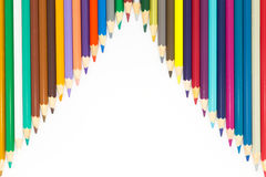 Fondo blanco con los lápices de madera de los colores Fotos de archivo libres de regalías