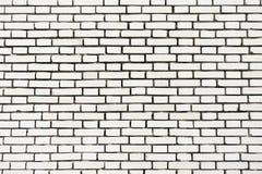 Fondo blanco de la pared de ladrillo en sitio rural Foto de archivo libre de regalías