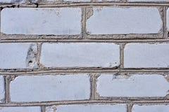Fondo blanco de la pared de ladrillo en sitio rural, foto de archivo