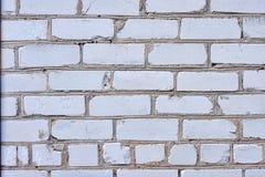 Fondo blanco de la pared de ladrillo en sitio rural imagenes de archivo