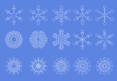 Fondo blanco del azul de los copos de nieve Fotos de archivo