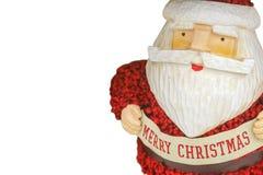Fondo blanco del grabar en madera colorido rústico santa con la bandera de la Feliz Navidad y del traje de punto mullido - sitio  Foto de archivo libre de regalías