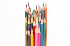 Fondo blanco sobre los lápices de madera de los colores Fotos de archivo libres de regalías