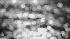 Fondo blanco y negro abstracto hermoso del bokeh de las luces que brilla 3840x2160 almacen de video