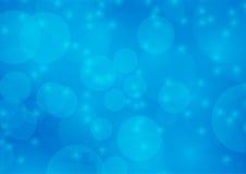 Fondo blu-chiaro astratto della sfuocatura di Bokeh Fotografia Stock