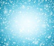 Fondo blu-chiaro di inverno con i fiocchi di neve fotografia stock