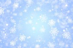 Fondo blu-chiaro di natale con i fiocchi di neve Immagine Stock Libera da Diritti
