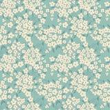 Fondo blu con i piccoli fiori svegli Fotografie Stock Libere da Diritti