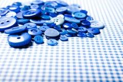 Fondo blu del bottone Immagini Stock