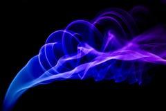 Fondo blu del nero di spirale del fumo Immagine Stock Libera da Diritti