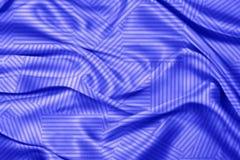 Fondo blu del tessuto di seta Immagine Stock