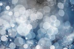 Fondo blu dell'estratto di festa con le stelle ed i fiocchi di neve Fotografia Stock Libera da Diritti