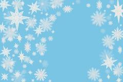 Fondo blu di Natale con i fiocchi della neve e stelle con blurre immagini stock libere da diritti