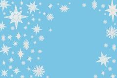 Fondo blu di Natale con i fiocchi e le stelle della neve Immagine Stock