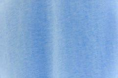 Fondo blu di struttura del prodotto di modo di colore della maglietta Immagini Stock