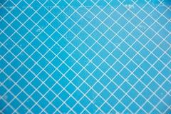 Fondo blu e bianco di griglia Immagini Stock