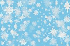 Fondo blu freddo di Natale con i fiocchi della neve e stelle con la b fotografie stock libere da diritti