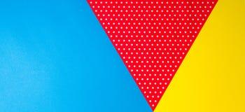 Fondo blu, giallo e rosso geometrico astratto della carta del pois Immagini Stock Libere da Diritti