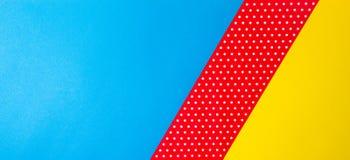 Fondo blu, giallo e rosso geometrico astratto della carta del pois Immagine Stock