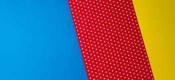 Fondo blu, giallo e rosso geometrico astratto della carta del pois Fotografia Stock