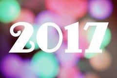 Fondo blured brillante con el texto: 2017 Fotos de archivo