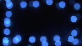 Fondo borroso azul abstracto del bokeh de las luces de la Navidad almacen de metraje de vídeo