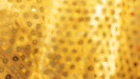 Fondo borroso del paño del oro Fotos de archivo libres de regalías