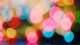 Fondo borroso extracto de Bokeh de las luces de la Navidad almacen de metraje de vídeo