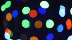 Fondo borroso extracto de Bokeh de las luces de la Navidad El árbol de navidad del centelleo enciende el centelleo Concepto de la metrajes