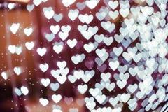 Fondo borroso forma del bokeh del corazón con las chispas Imágenes de archivo libres de regalías