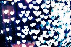 Fondo borroso forma del bokeh del corazón con las chispas Foto de archivo libre de regalías