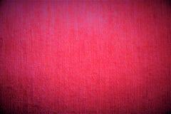 Fondo borroso mullido saturado de la materia textil de la tela carmesí rosada suave del terciopelo Fotos de archivo