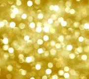 Fondo borroso, oro, flameando, brillo, círculos amarillos, holi