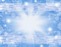Fondo brillante de la Navidad con las luces, la nieve y el bokeh Imagen de archivo