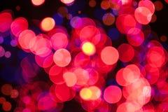 Fondo brillante de la Navidad con las luces rojas Foto de archivo libre de regalías