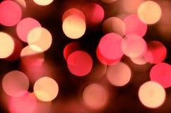 Fondo brillante de la Nochebuena El un montón de bokeh chispeante de oro de la guirnalda defocused se enciende foto de archivo