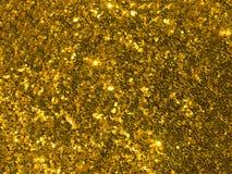Fondo brillante dei coriandoli di scintillio dell'oro Fotografie Stock