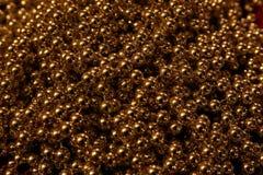Fondo brillante del brillo del oro oscuro foto de archivo libre de regalías