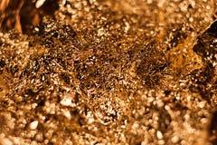 Fondo brillante metallico di struttura della carta da imballaggio della foglia della stagnola di oro per l'elemento della decoraz Fotografia Stock Libera da Diritti