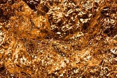 Fondo brillante metallico di struttura della carta da imballaggio della foglia della stagnola di oro per l'elemento della decoraz Fotografia Stock
