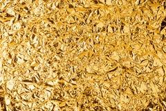 Fondo brillante sgualcito di struttura della stagnola dorata, progettazione di lusso dell'oro brillante luminoso, superficie meta immagini stock