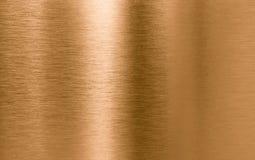 Fondo bronzeo o di rame di struttura del metallo Immagini Stock Libere da Diritti