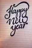 Fondo caligráfico de la Feliz Año Nuevo Imagen de archivo