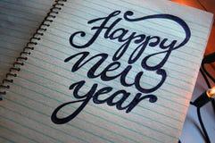Fondo caligráfico de la Feliz Año Nuevo Fotografía de archivo libre de regalías