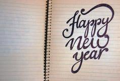 Fondo caligráfico de la Feliz Año Nuevo Imagen de archivo libre de regalías