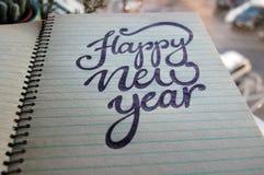 Fondo caligráfico de la Feliz Año Nuevo Fotos de archivo