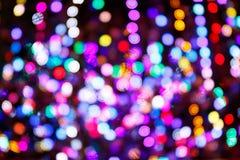 Fondo che consiste di un gran numero di luci variopinte delle forme rotonde differenti luminose, immagini del bokeh fotografia stock libera da diritti