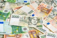 Fondo checo y euro de los billetes de banco Imagenes de archivo